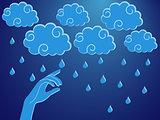 Human hand touching a rain droplet