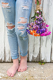 teenage girl in frayed blue jeans