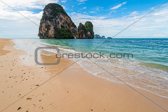 Waves on the shores of the Andaman Sea and a view of the rock