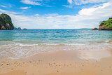 Sandy beach and turquoise sea in a tropical place of Thailand