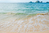 Waves of the Andaman Sea close-up, sandy beach