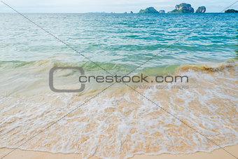 Waves of the Andaman Sea close-up, sandy beach