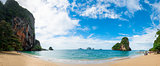 Beach Phra Nang on a sunny day panoramic view, tourists in the f