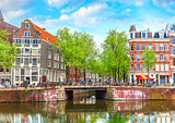 Bridge over channel in Amsterdam Netherlands houses river Amstel