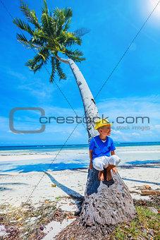 Boy in hat, sea beach