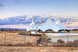 Sunset over a large circus tent