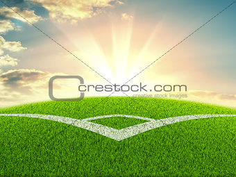 Football field on the background of sunrise