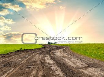 A dirt road against beautiful sunrise