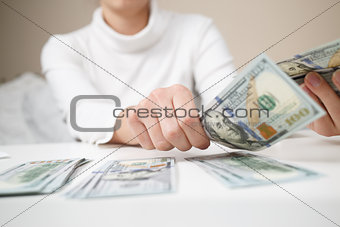 Close up of woman with calculator counting money