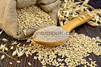 Bran flakes oat in spoon on board