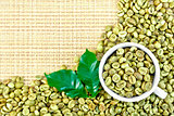 Coffee green grains with cup on yellow woven fabric