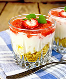 Dessert milk with strawberry in glassful on board and napkin