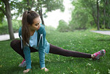 Portrait of young and sporty woman in sportswear doing yoga or Stretching exercises