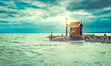 Lighthouse on shore sea with lighting lantern