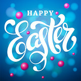 Happy Easter lettering card. Modern calligraphy with bokeh