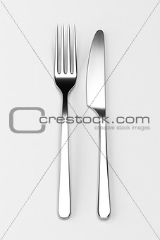 Fork and knife on grey
