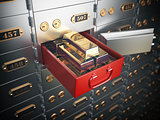 Open safe deposit box with  golden ingots. Financial banking inv