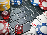 Casino online. Gambling chips , cards and dice on laptop compute