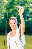 Sport fisherwoman showing her catch