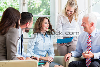 Business women and men in office having presentation