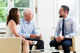 Financial advisor consulting couple in retirement planning