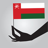 Hand with flag Oman