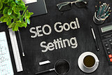 SEO Goal Setting - Text on Black Chalkboard. 3D Rendering.