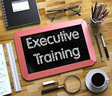 Executive Training - Text on Small Chalkboard. 3D.