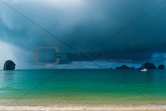 calm sea and rain clouds in front of a tropical rain, the boat i