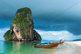 Small traditional Thai boats off the coast of Phra Nang, Thailan
