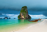 Wooden boats and a high cliff in the sea, Thailand, Phra Nang be
