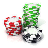 Stacks of red, green and black gambling chips