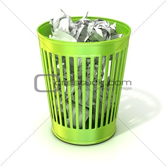 Green trash bin, full of crumpled paper
