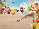 Chef with board and vegetables background