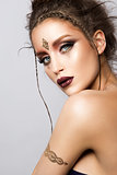 Glamour portrait of beautiful woman model with gold makeup and romantic hairstyle.