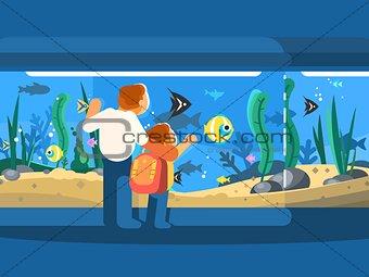 Dad with son in oceanarium