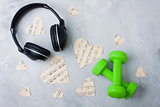 Flatlay sport music composition headphones paper hearts dumbbell
