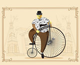 Man on penny farthing bicycle on old city background. Vector ill