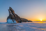 View of Ogoy Island in Frozen Lake Baikal at sunrise