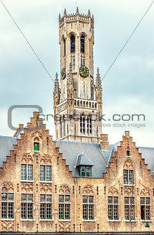 Tower Belfort in Bruges Belgium on background