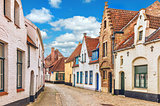Vintage street in Bruges Belgium with blue