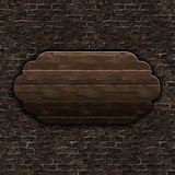 3D wooden sign on brick wall