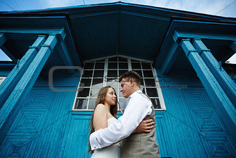 Awesome young wedding couple embracing