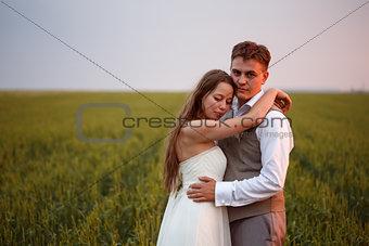 Beautiful wedding couple posing at the nature