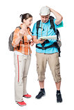 Two lost tourists look at the map on a white background in the s