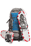 a pair of snowshoes and backpack traveler in the winter