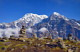 Mountain Landscape in Himalaya. Piramid of stones. Annapurna South peak, Hiun Chuli.