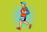 Boy student with a backpack goes to school or Hiking
