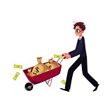 Worried businessman in glasses pushes wheelbarrow full of money bags