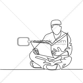 Man in fez reading Koran.